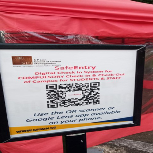 Scan the QR code at the main gate while entering and exiting