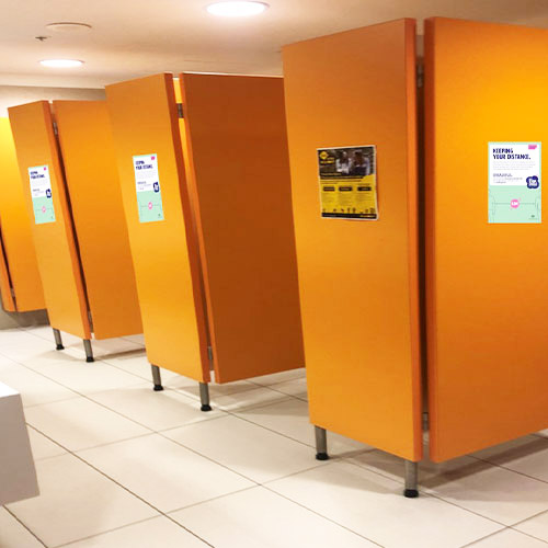 Signage highlighting social distancing and hygiene measures placed in washrooms